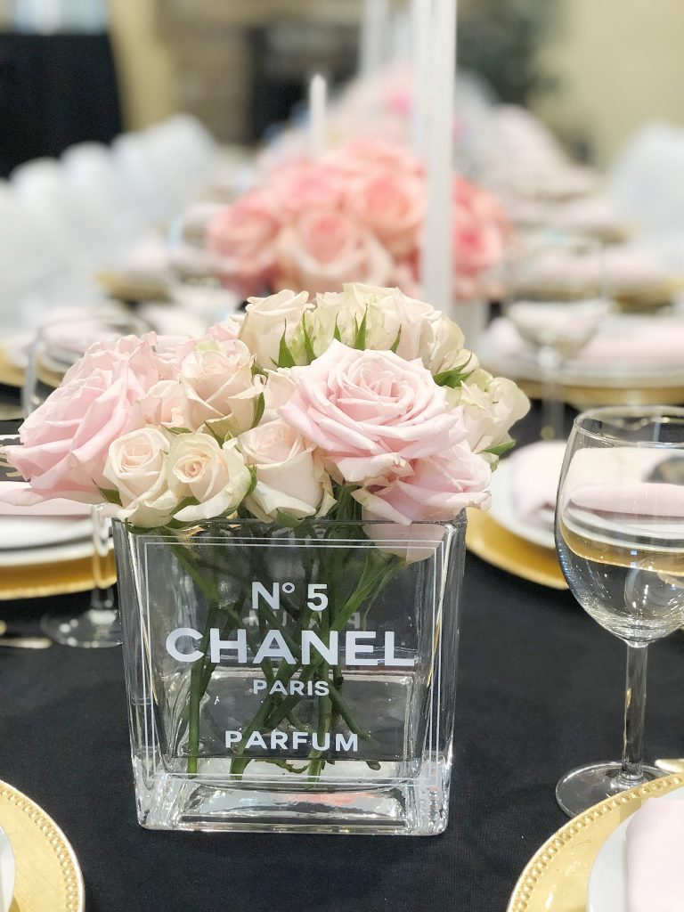 chanel no. 5 centerpiece, chanel party centerpieces, coco chanel perfume bottle flowers, chanel party ideas, chanel party decor